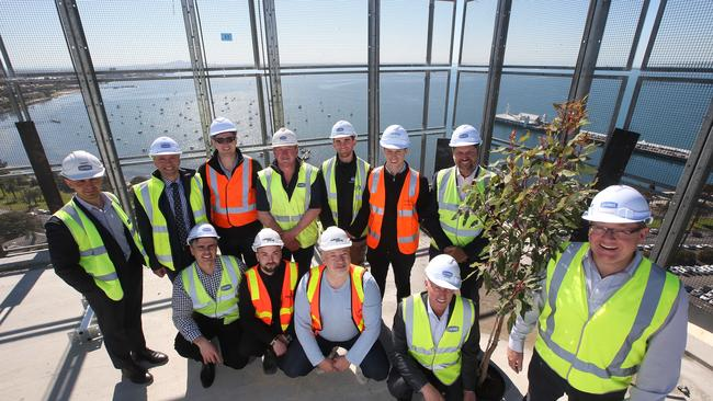 Developer James Morphy, right, with representatives of the project team delivering Miramar posed for a photo on the roof of the building. Picture: Glenn Ferguson