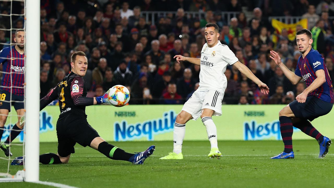 Lucas Vazquez of Real Madrid opens the scoring against Barcelona.