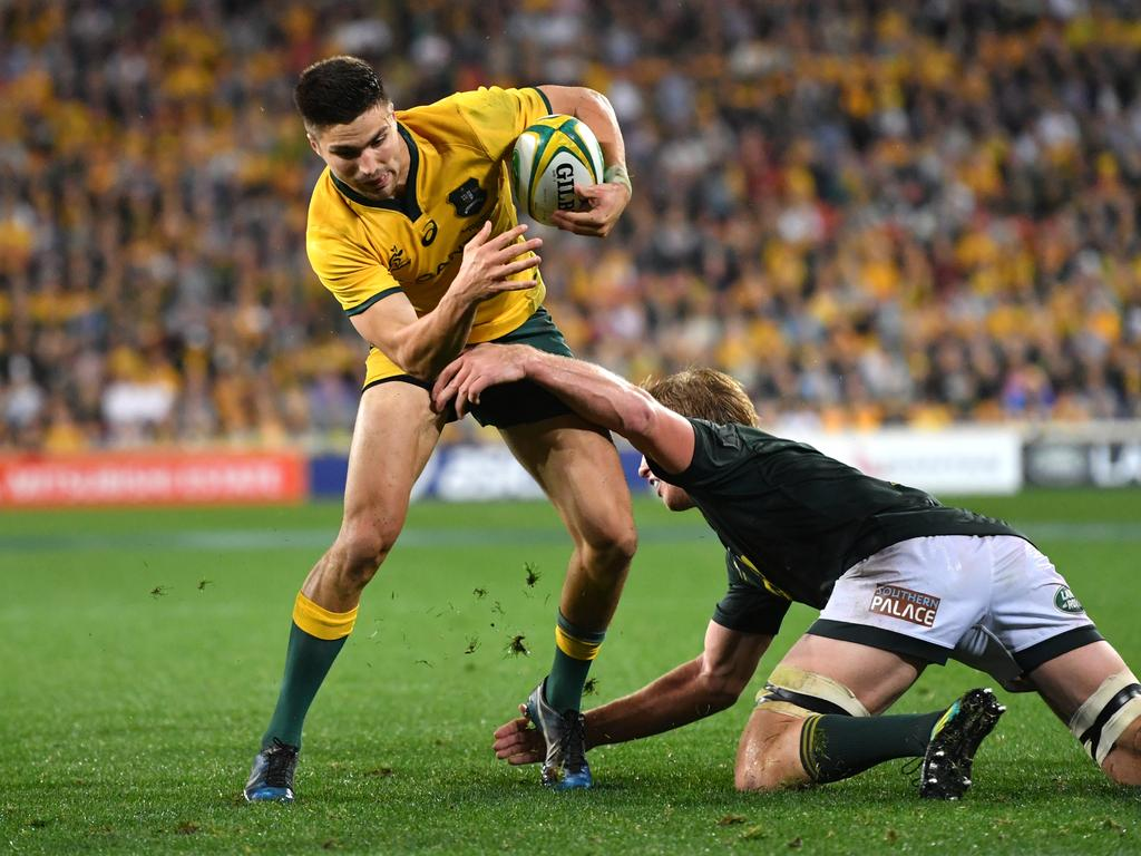 Jack Maddocks (left) of the Wallabies is tackled by Pieter-Steph du Toit (right) of the Springboks during the Rugby Championship match between Australia and South Africa at Suncorp Stadium in Brisbane, Saturday, September 8, 2018. (AAP Image/Darren England) NO ARCHIVING, EDITORIAL USE ONLY