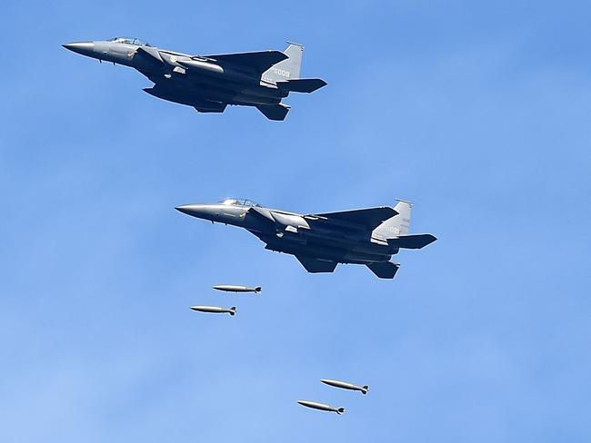 South Korea's F-15K fighter jets drop bombs during a training at the Taebaek Pilsung Firing Range on Ain Gangwon-do, South Korea. Picture: Getty