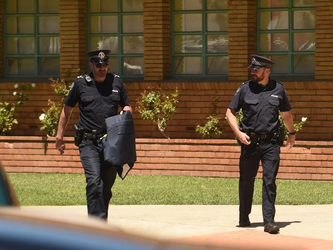 Police at a locked-down Adelaide High after the bomb threat was called. Photo: Sam Wundke