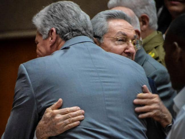 Raul Castro embraces Miguel Diaz-Canel after he is named as the candidate to succeed him as president. Picture AFP