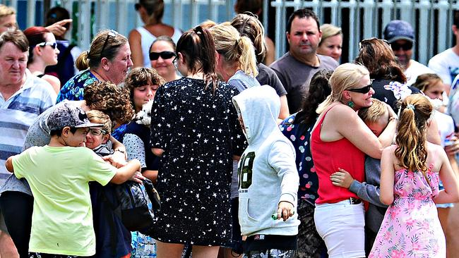Grade 6 Willow State School students are reunited with their families. Picture: Zak Simmonds