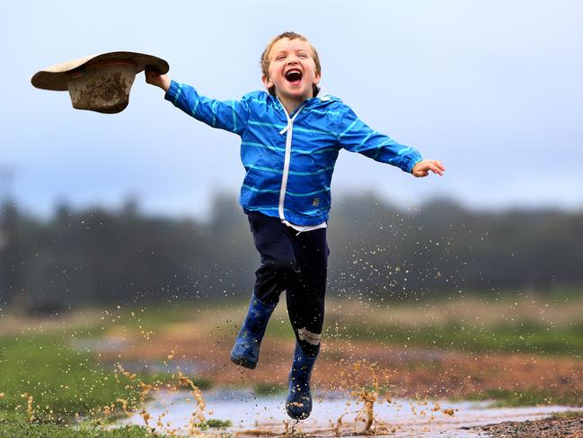 Nayte Crowley, 4, welcomes the rain at Warwick on the southern Darling Downs. Picture: Adam Head