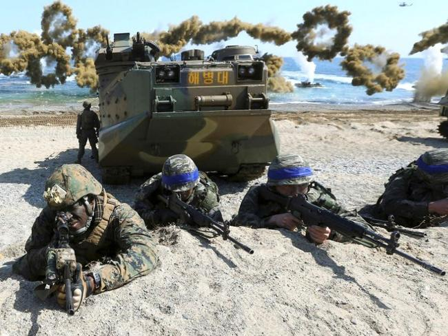 Marines of the US and South Korea take positions after landing on a beach during a joint military combined amphibious exercise last year. Plans detailing such events are believed among data stolen by North Korean hackers. Picture: Kim Jun-bum/Yonhap via AP