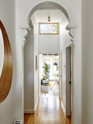 The hallway is all charm with its period details.