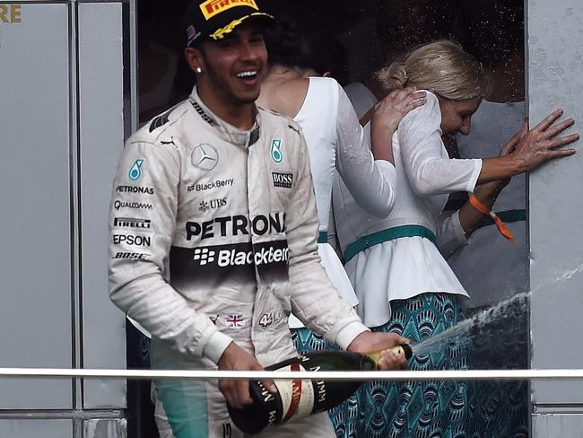 Lewis Mercedes spraying champagne on grid girls in Malaysia in March.