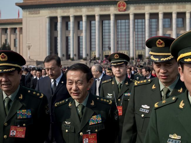 """China will raise defence spending by """"around seven per cent"""" this year as it guards against """"outside meddling"""" in its disputed territorial claims, a top official said on March 4, 2017. Picture: AFP."""