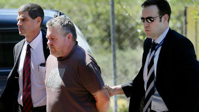 Police leading Rick Thorburn into Logan Police Station for questioning in 2016. File picture.