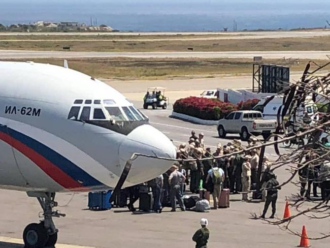 Russian troops are seen disembarking from a transport plane outside Caracas, Venezuela. Picture via Federico Black B