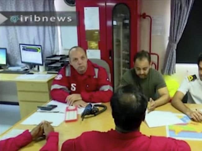 In this photo released by state-run IRIB News Agency, crew members of the British-flagged tanker Stena Impero, that was seized by Tehran in the Strait of Hormuz on Friday, hold a meeting. Picture: IRIB News Agency via AP.
