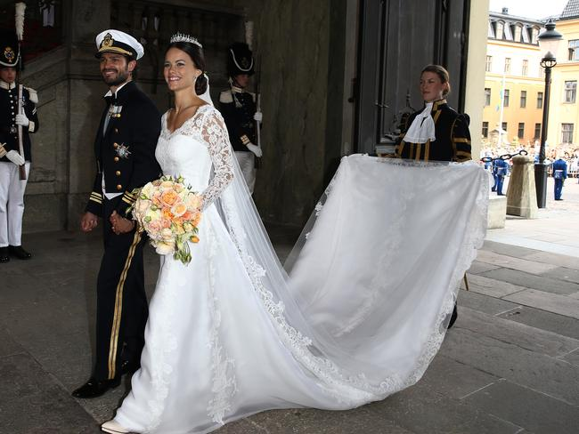 Long train ... Prince Carl Philip of Sweden is seen with his new wife Princess Sofia of Sweden. Picture: Getty