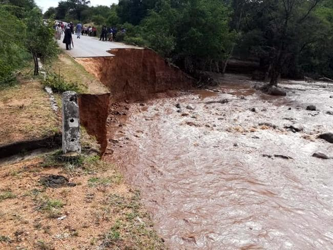 Locals look at a damaged bridge after Cyclone Idai hit, in Chimanimani, Zimbabwe. Picture: AP