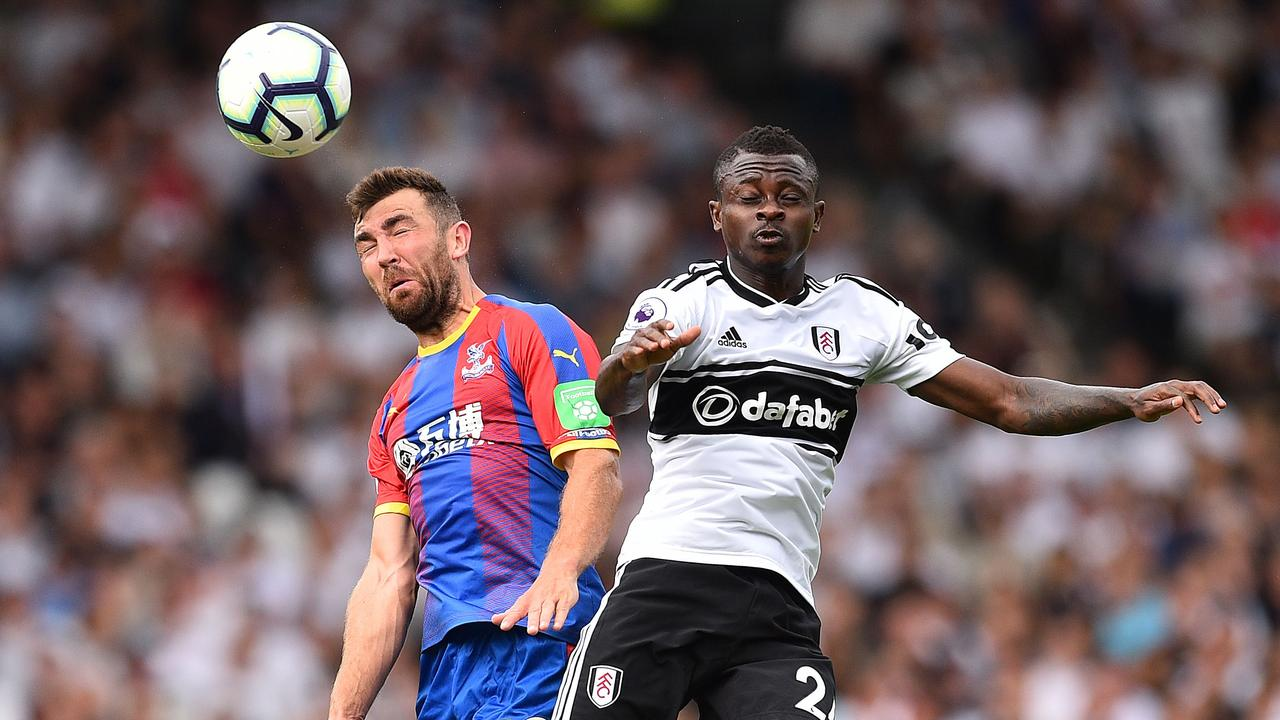 Crystal Palace's James McArthur (L) vies with Fulham's record signing Jean Michael Seri.