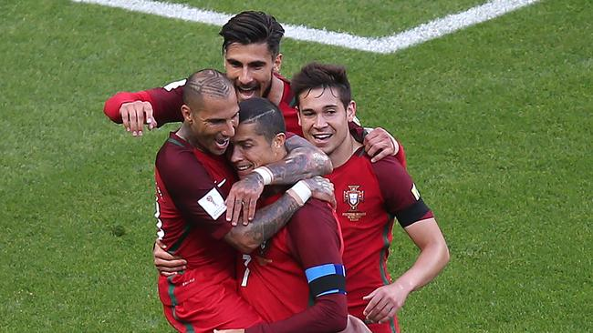 Portugal's forward Ricardo Quaresma (L) and Portugal's forward Cristiano Ronaldo (C) celebrate