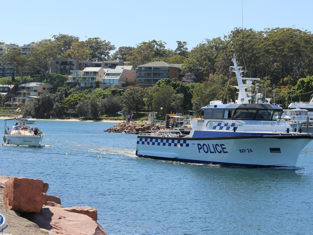 A police vessel tows the listless yacht into Nelson Bay at Port Stephens on Saturday. It was a week-long operation save the yachtsmen. Picture: Supplied by NSW Police