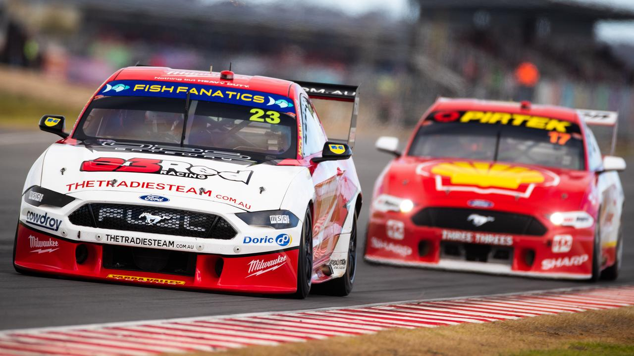 Will Davison is chased by Scott McLaughlin on Sunday at The Bend.