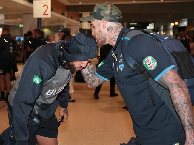 Josh Dugan plants a kiss on Blake Ferguson.