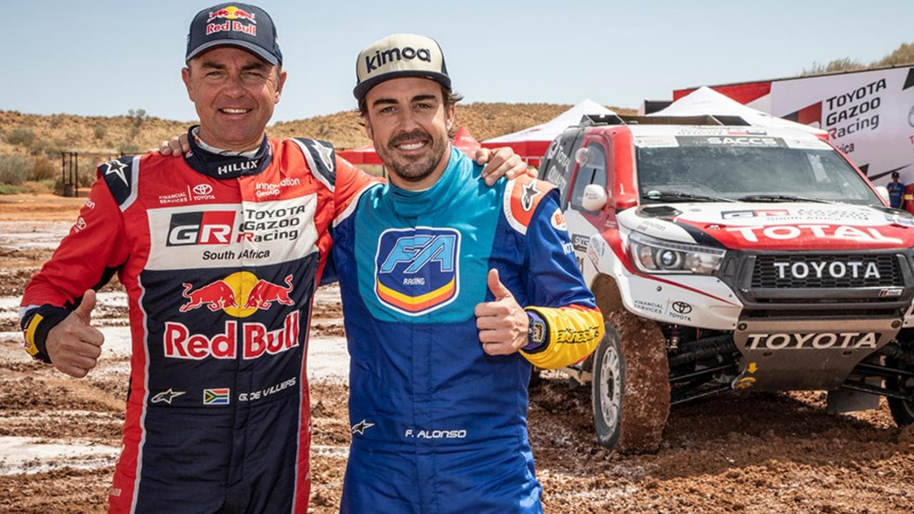Alonso with 2009 Dakar winner Giniel De Villiers.