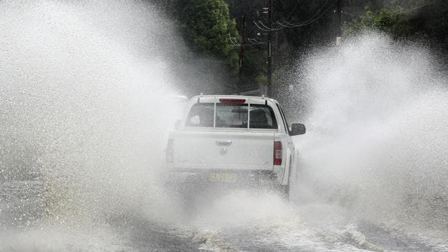 The Central Coast (above) was pummelled by rain on Wednesday. Pictures: AAP Image/Mark Scott