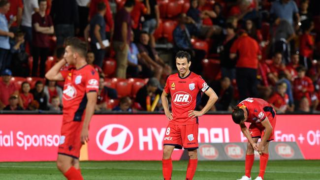 Adelaide United players after losing to Perth Glory in Round 22.
