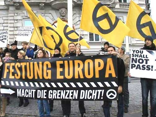 Far-right activists at an Identitarian Movement of Austria anti-immigration rally in Vienna holding signs reading 'Fortress Europe', 'Close the Borders Now!', 'My Home is Not an Immigrant Country', and 'Europe, Youth, Reconquista' (a series of wars between Christians and Muslims in Europe during the Middle Ages). Picture: Ataraxis1492/Wikimedia Commons