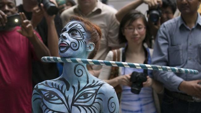 A model hula hoops after being painted at the inaugural Bodypainting Day in NYC. Photo: John Minchillo.