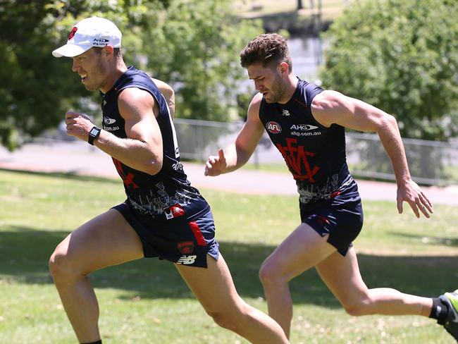 Jake Melksham and Tom Bugg lead the way as Melbourne players took part in gruelling hill sprints at The Tan. Picture: Wayne Ludbey