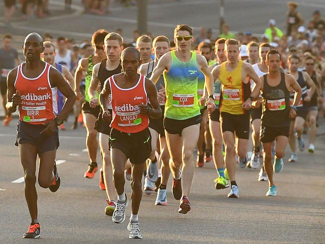 Isaac Birir leads the field up the hill in the men's Melbourne Marathon. Photo: Quinn Rooney/Getty Images