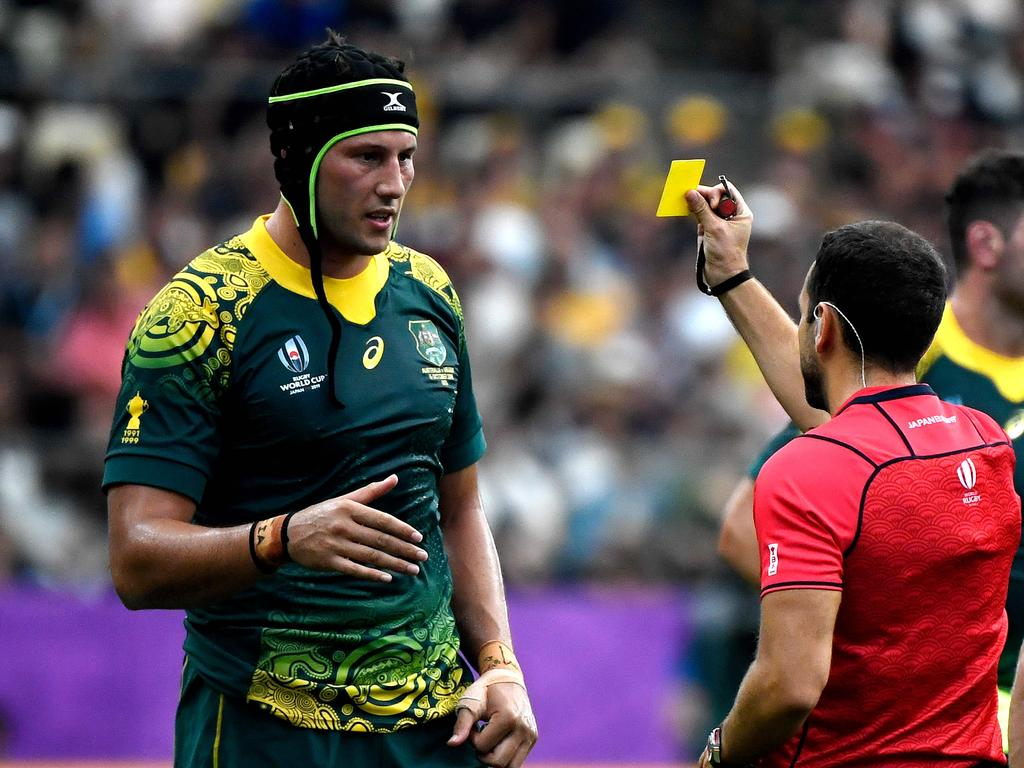 Match referee Mathieu Raynal (R) shows a yellow card to Australia's lock Adam Coleman during the Japan 2019 Rugby World Cup Pool D match between Australia and Uruguay at the Oita Stadium in Oita on October 5, 2019. (Photo by CHRISTOPHE SIMON / AFP)