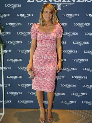 Rebecca Valance wore one of her own designs, a pink cap sleeved dress. Picture: Tim Hunter.