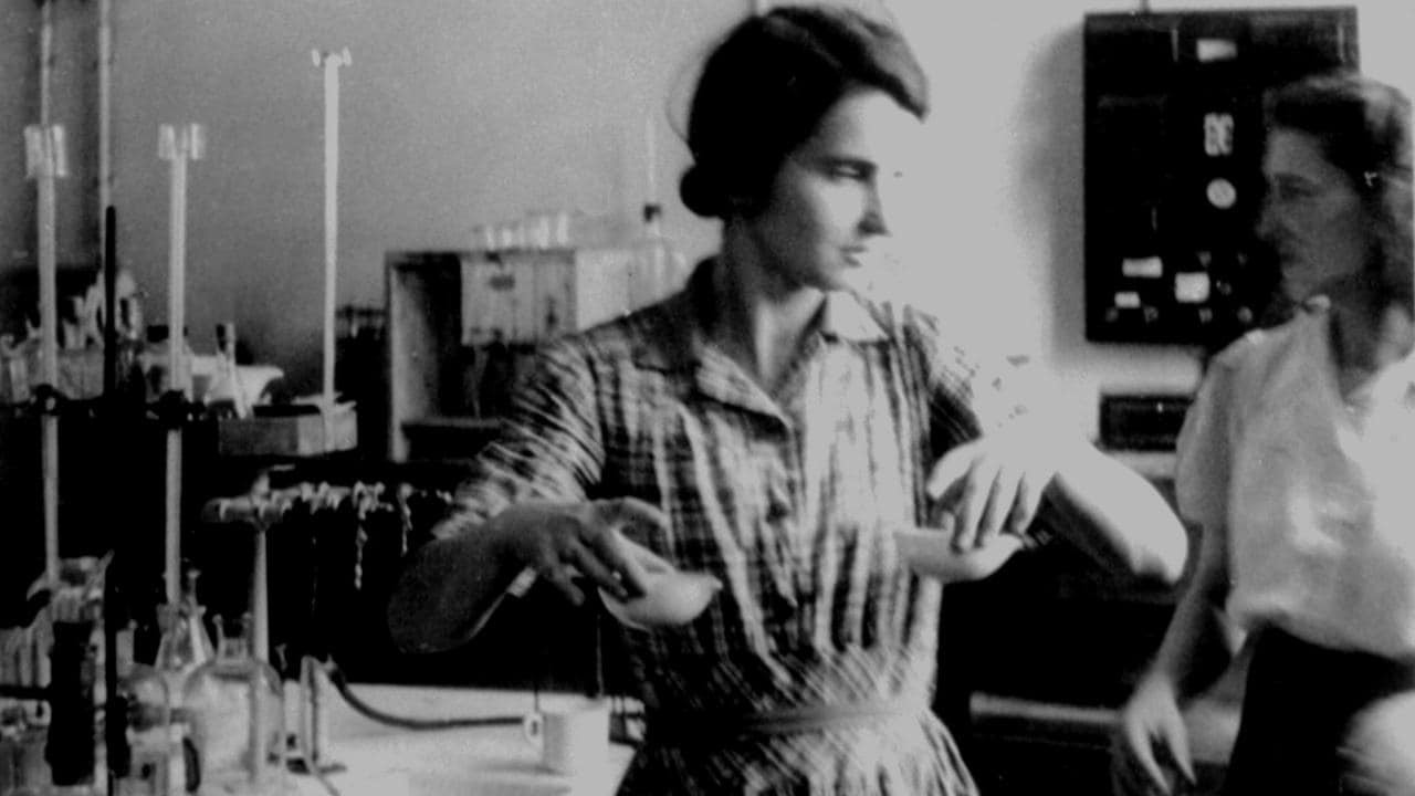 Rosalind Franklin (centre) and a colleague in the laboratory.