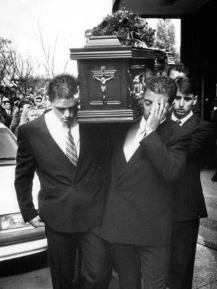 Greg carrying his brother's casket at his funeral.