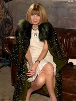 Editor-in-Chief of American Vogue Anna Wintour shows how to take a fashionable break from partying as she attends the CHANEL Dinner. Picture: WireImage