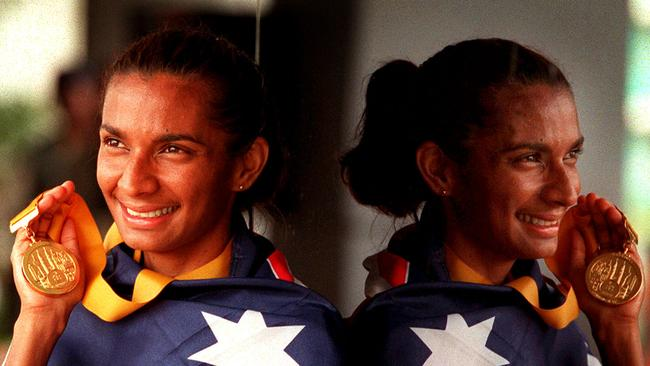 Nova Peris-Kneebone with her Commonwealth Games gold medal & draped in an Australian flag. Picture: Gregg/Porteous.