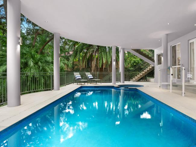 The home includes a covered in-ground pool and spa.