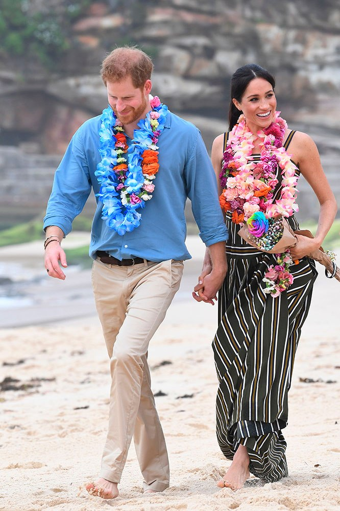 Meghan Markle and Prince Harry walk barefoot on Bondi Beach, Sydney, October 2018. Image credit: Getty Images