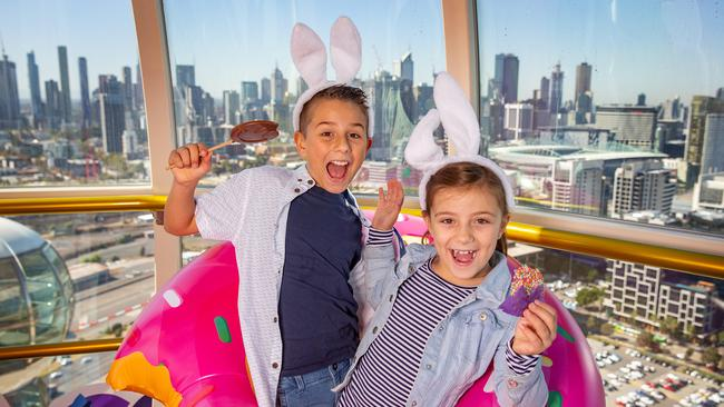 Murat, 10, and Larah, 8, get into the Easter spirit at the Melbourne Star Observation Wheel. Picture: Sarah Matray
