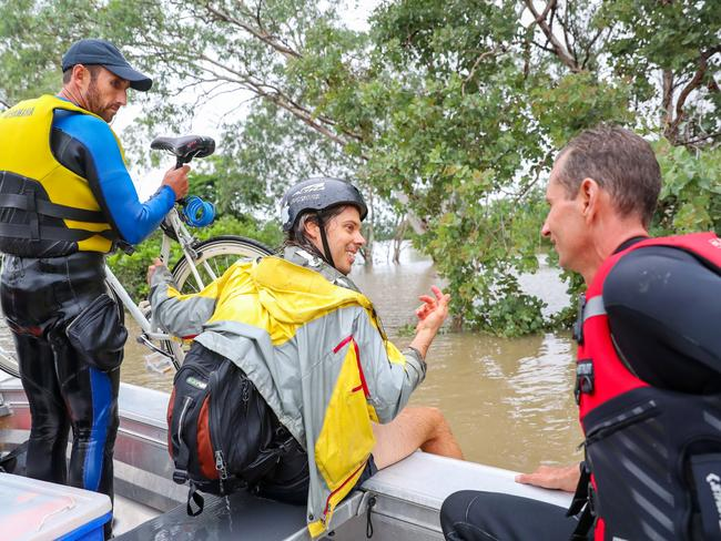 Levi Chalmers was rescued while riding his push bike through 1.8m crocodile infested floodwaters by police diving unit officers. Picture: Michael Chambers