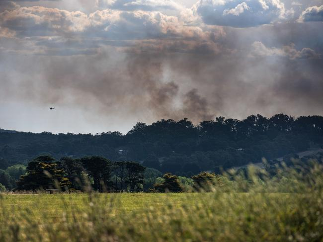 Thick smoke in the sky as tankers and aircraft battle the blaze. Picture: Ian Wilson