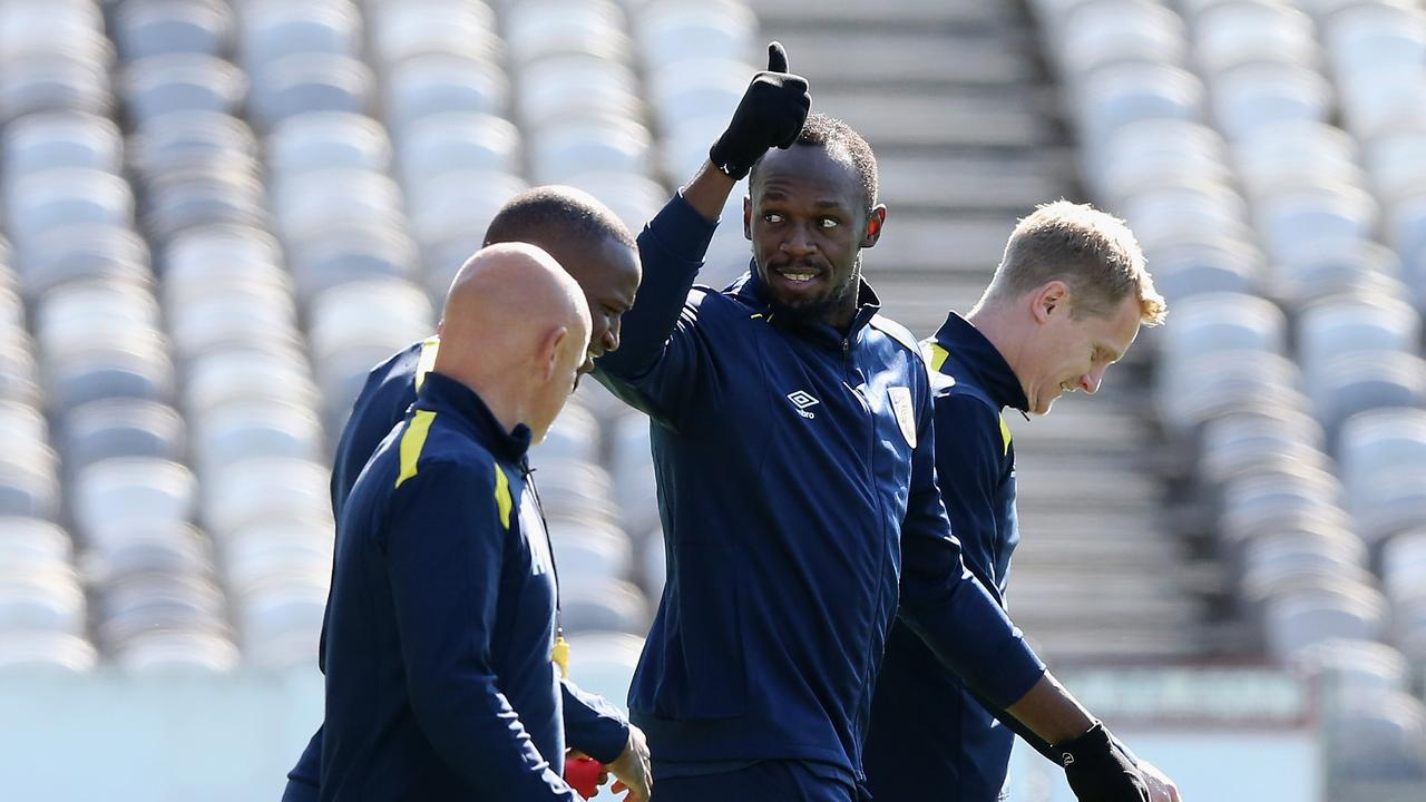 Usain Bolt warms up during his first training session with the Central Coast Mariners.