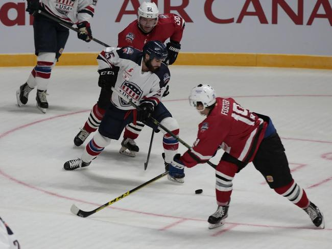 Players battle it out during the Ice Hockey Classic this year.