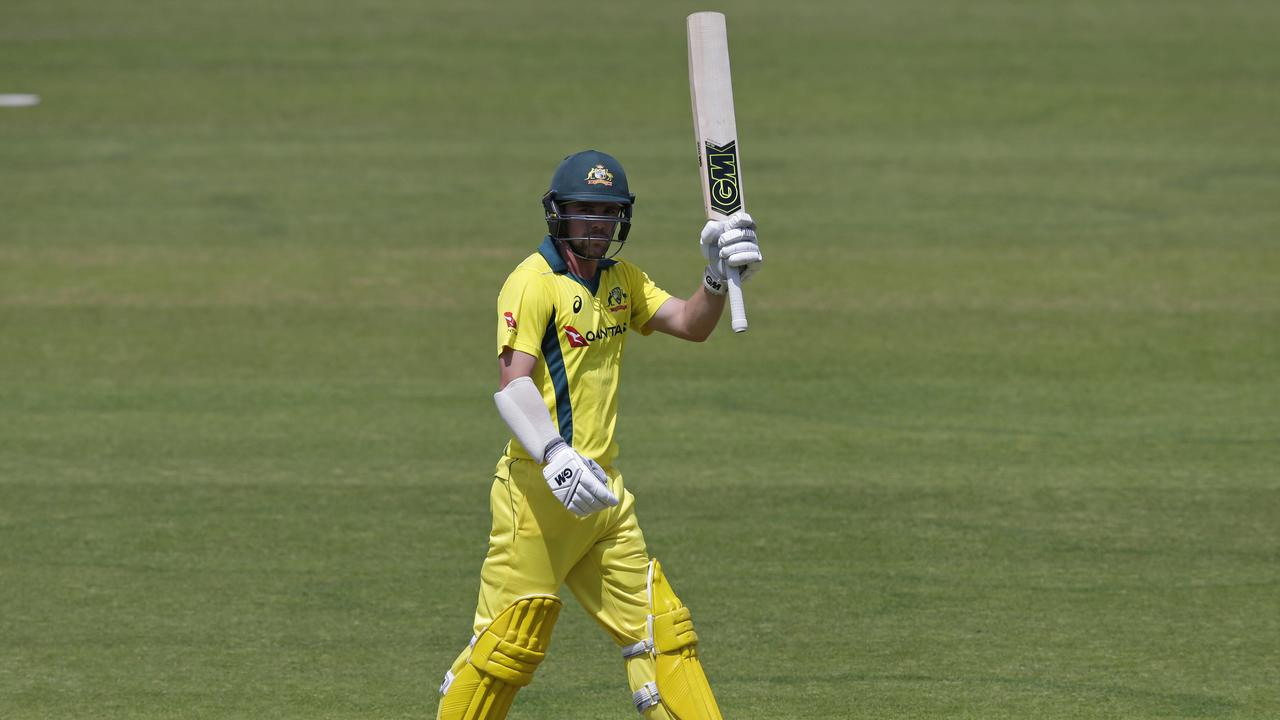 Australia's Travis Head celebrates bringing up his half-century against Middlesex at Lord's on Saturday.