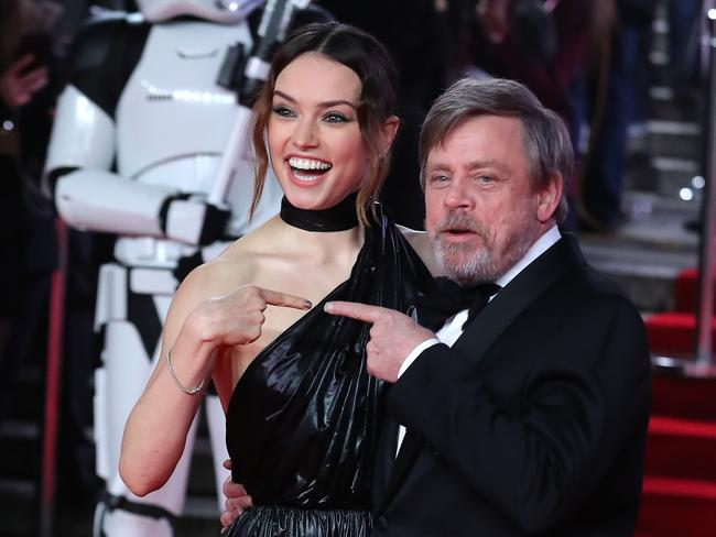 Daisy Ridley and US actor Mark Hamill as they pose on the red carpet for the European Premiere of Star Wars: The Last Jedi at the Royal Albert Hall in London. Picture: AFP