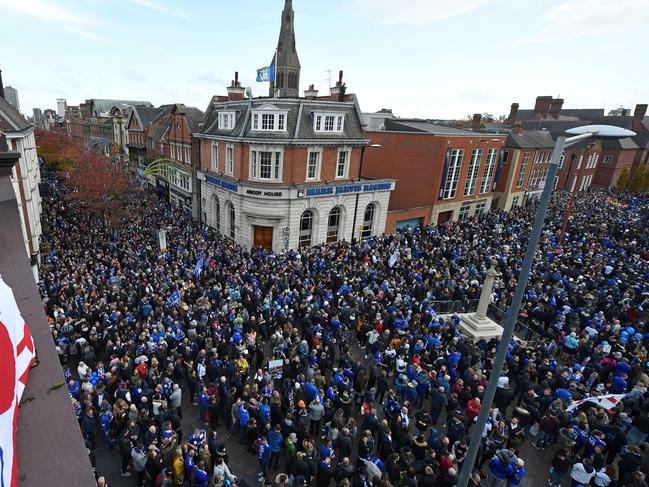 People gather in Jubilee Square to take part in what is being dubbed as the 'Vichai March' or the '5000-1' march towards the King Power Stadium. Picture: AFP