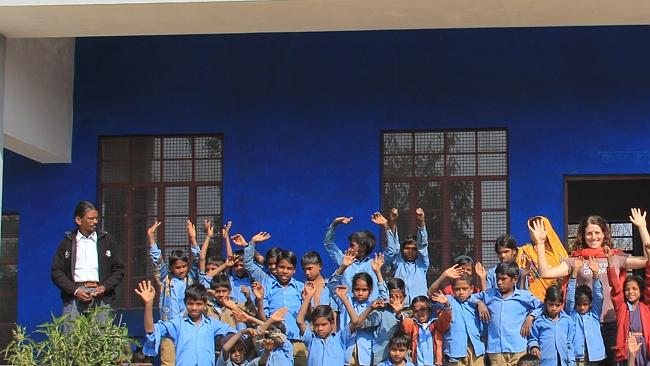 Kristy celebrates the last day of school with children in India. Picture: Supplied