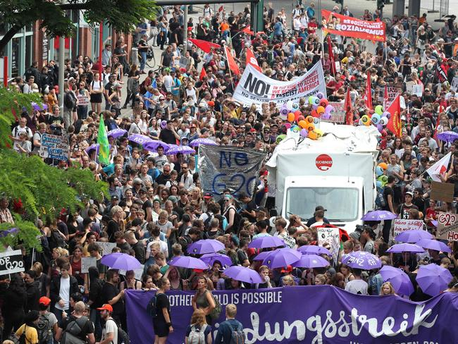 A rally near a concert hall where the leaders will head after the meeting for a concert. Picture: AFP PHOTO / Ronny HARTMANN