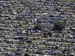 An aerial view of the 'Ute Paddock' at the 2017 Deni Ute Muster on September 30, 2017 in Deniliquin, Australia. The annual Deniliquin Ute Muster is the largest ute muster in Australia, attracting more than 18,000 people to the rural town of Deniliquin together to celebrate all things Australian and the icon of the Ute in a weekend of music, competitions and camping. (Photo by Brook Mitchell/Getty Images)