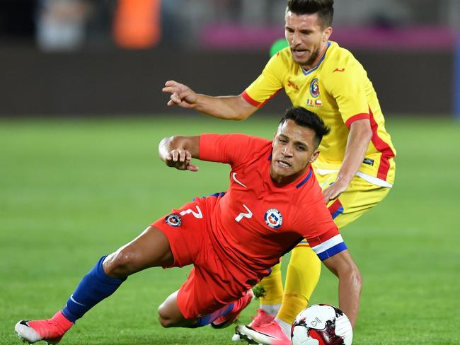 Alexis Sanchez (L) of Chile vies for the ball