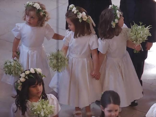 Princess Charlotte took her role as bridesmaid at Meghan and Harry's wedding very seriously. Picture: BBC via YouTube